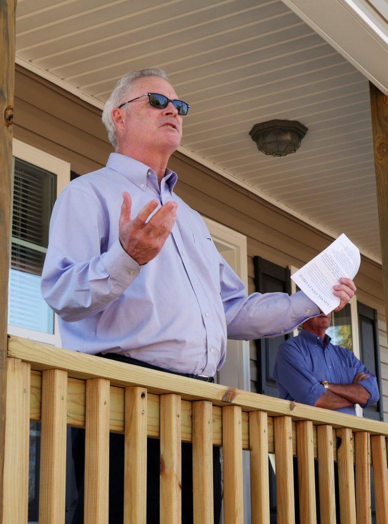 Habitat North Carolina Executive Director Greg Kirkpatrick speaks to the crowd at the dedication of Wanda and Annie Weaver's new home.