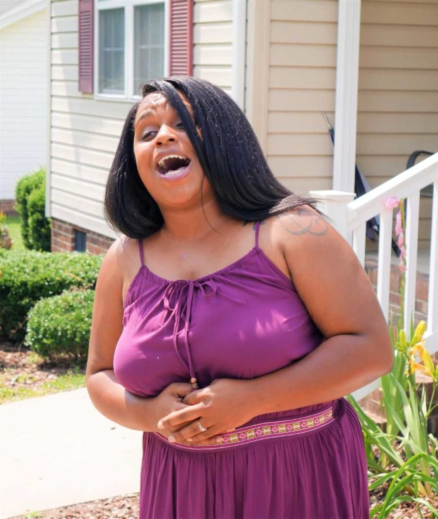 """Jasmine Goins, a daughter of Greg and Mechelle Goins, sings """"I can't give up now"""" during the dedication ceremony."""
