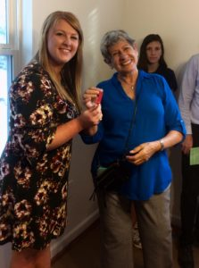 Jana Reid, left, of the Pittboro branch of the State Employees Credit Union, presents Adela Diez with the keys to her new home on Acorn Park Lane in Pittsboro.