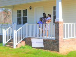 Shavonda Smith and her children Jayden, 9, and Mia, 3, welcomed about 30 well-wishers to their new home in Ahoskie on Sunday.