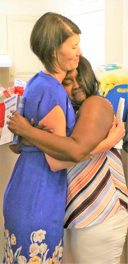 Katie Page, executive director of Habitat for Humanity of Cabarrus County, shares an emotional moment with new homeowner Paditra Carlton during the dedication ceremony for Carlton's home on Young Avenue in Concord.